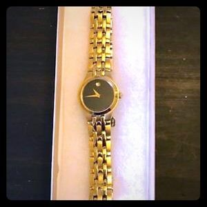 Ladies Movado stainless steel gold tone watch